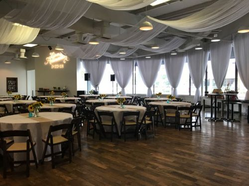 Wedding of Lisa & Hannah, round tables in front of white draped full length windows, 660 LaFayette Street, Horton Events Downtown Nashville