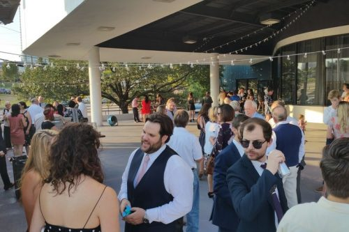 Laughing and smiling people on the patio at 660 LaFayette Street, Horton Events Downtown Nashville